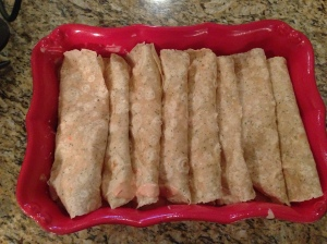 Enchiladas all lined up in a row...